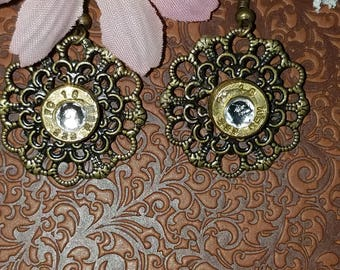 Nickel Free Filigree earrings with a spent brass cartridge and crystal in the center.