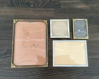 Four antique / vintage gilded picture frames with glass