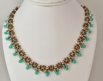 Ruthie Necklace: Turquoise, gold, bronze, Swarovski crystals and pearls, 18 inches long.  So elegant!