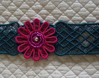 Free-standing lace bracelet or cuff.