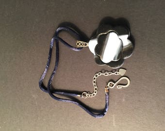 Black Blue and White Pendant on Blue Cord