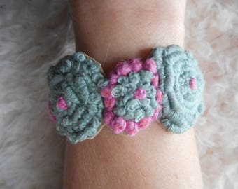 Blue and pink bracelet with embroidery