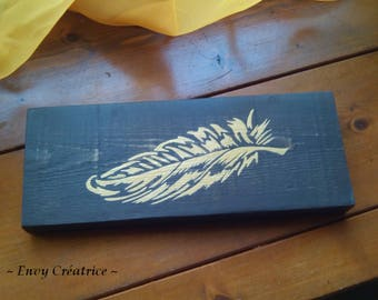 """Painting """"Golden Feather"""" on a black background pallet wood"""