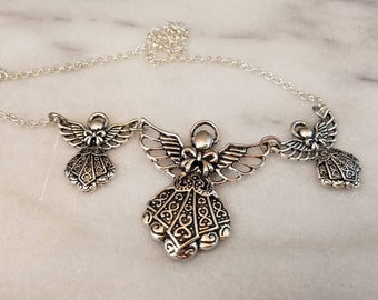 Beautiful necklace with 3 silver angels