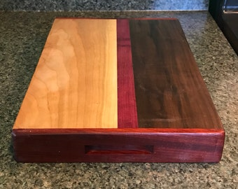 Maple, walnut, padauk and purpleheat cutting block