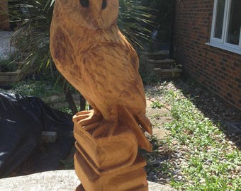 Barn Owl carving perching on four timber books