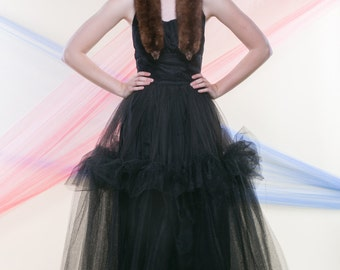ROXY (Size 1-2): Black halter gown with full skirt constructed of layers of lace and tulle.