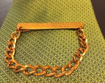 "Giant Grip tie bar clip, hammer-like design. Measures 2 1/4"" long."