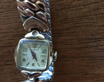 Bulova 10k rgp vintage swiss ladies/womens  gold plate  mechanical wind  silver dial gold hands  watchruns well made 1955