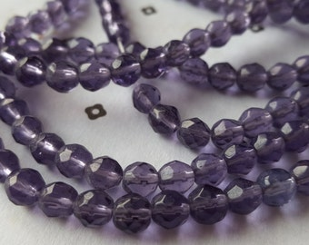 Purple round faceted glass beads 6mm