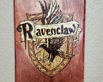 Ravenclaw sigil wood burned wall art.