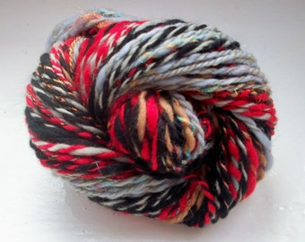 Handspun art yarn -  merino, rainbow sparkle, red, black, grey, 73g by SpinningStreak