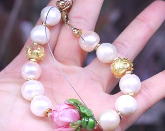 Freshwater pearl bracelet with rose focal and gold foil decorated spacer beads