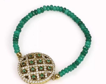 Emerald and topaz det in sterling silver allowing many emeralds to be the actual bracelet purce