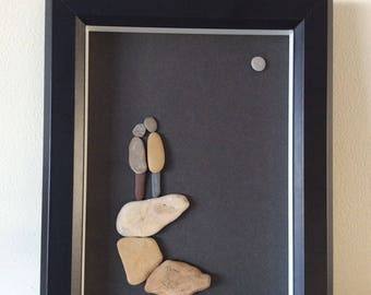 Framed pebble art picture of A couple