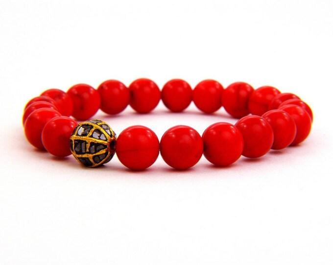 Red Coral and 1.00 carat black diamond bracelet