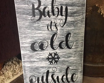 "Rustic, hand-painted 16"" x 10"" wood sign, customizable, available in various sizes per request, ""Baby its cold outside"""