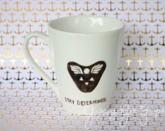 STAY DETERMINED and Delta Rune symbol - Undertale quote mug