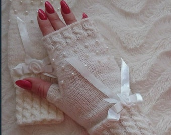 Soft and beautiful wrist warmers with pearls and rose. Hand knitted arm warmers. White pearls and ribbon.