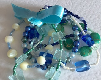 Blue and green bracelet bunch