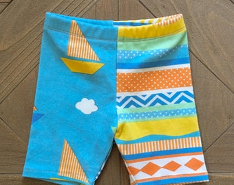 Two Toned Organic Boy Shorts - Size Infant - Toddler. Cotton shorts. Blue Sailboat and Cloud Shorts w/ orange, green & yellow stripe.