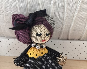 Doll brooch.