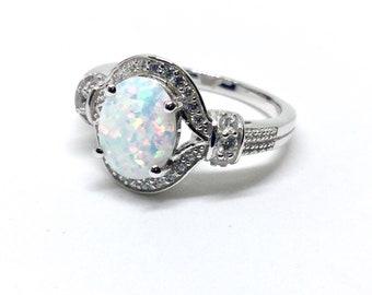 Elegant lab opal sterling silver ring