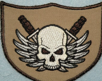 """Winged Skull with Crossed Daggers Shield Iron on Patch 3 7/8"""" x 3 1/4"""""""
