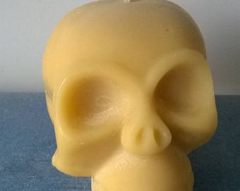 Candle crafted in the shape of skull color natural wax