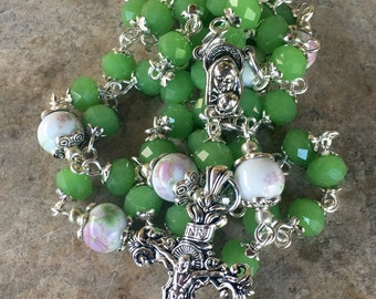 Rosary, handmade with lime green czech glass and floral ceramic beads. Ornate tibetan silver crucifix and Holy Mary connector.
