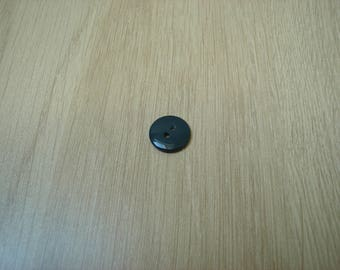 flat round blue grey plastic button