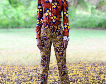 DANITA SHIRT Made in African wax print, this shirt has a slim fit, narrow shoulders and a gently tapered waist