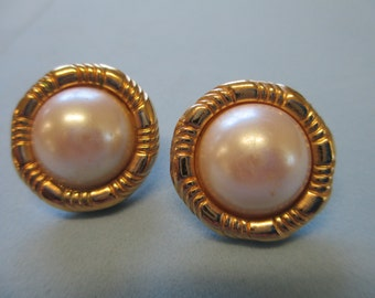 Vintage gold toned round white pearl center pierced Earrings. Not Signed used