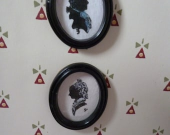 A pair of Victorian style Hand painted Miniature Silhouettes one 12th scale