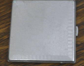 vintage tooled metal cigarette case