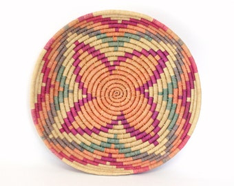 "Colorful Coil Basket in Hues of Pink, Orange, Green, & Beige with Flower Shape At Center (13"" Diameter)"