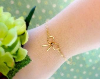 Gold bow bracelet, bridal jewelry, minimal bracelet, bridesmaid gifts, Tie the knot bracelet, weddings, bridal jewelry, Otis B, Briguysgirls