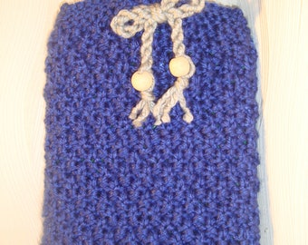 Hot water bottle and knitted coating in blue winter