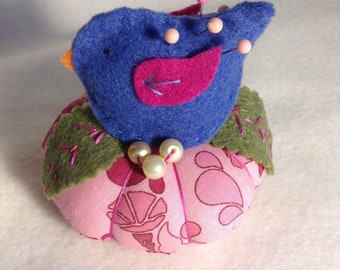 Bird on nest with pearl eggs pincushion