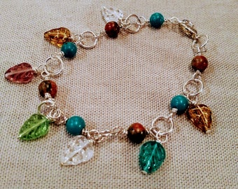 Semi precious gemstone bracelet with Czech glass leaves, wire wrapped silver bracelet, turquoise and unakite bracelet