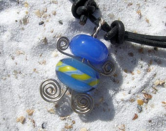 hand made medieval inspired glass and silver pendant