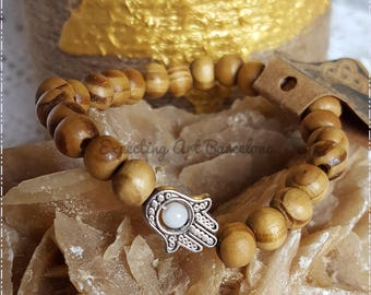 Hand-held Fatima wooden bracelet with marble stone inside.