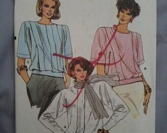 Vintage Vogue Pattern 9499 Misses'/Petite Blouson Blouse, Loose Fitting, Tuck Variations, Extended Shoulders, Back Button Closing. Size 8