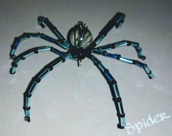 Handmade spider/ black and white AB body and legs are light blue and dark blue.