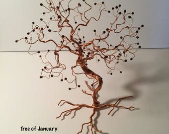 Celebration Trees of Copper Wire and Austrian Crystal.  One for each month of the year.