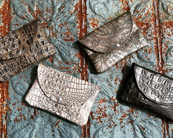Embossed leather clutches!!