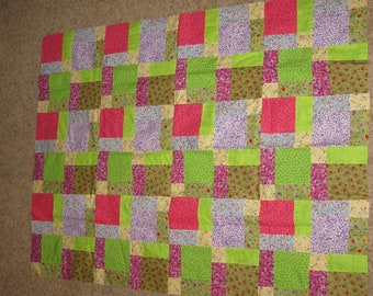 Tossed nine patch quilt top