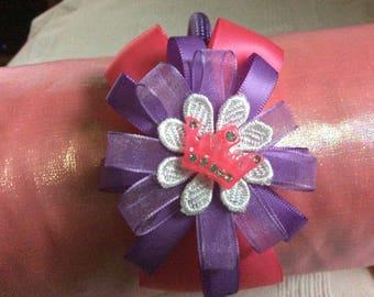 Pink & lilac handmade ribbon flower on a woven headband.