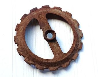 Rusty antique metal seed planter wheel