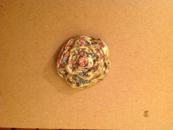 pendant ,Tudor rose style  handmade of clay ,swaroviski crystal ,semiprecious  pyrite in golden color